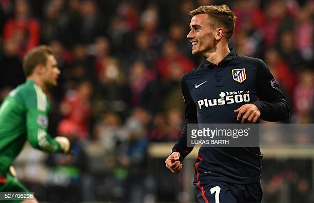 Atletico Madrid's French forward Antoine Griezmann celebrates scoring past Bayern Munich's goalkeeper Manuel Neuer during the UEFA Champions League...