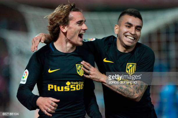 Atletico Madrid's French forward Antoine Griezmann celebrates with Argentinian midfielder Angel Correa after scoring during the Spanish league...