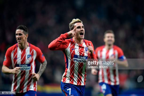 Atletico Madrid's French forward Antoine Griezmann celebrates with teammates after scoring a goal during the UEFA Champions League group C football...