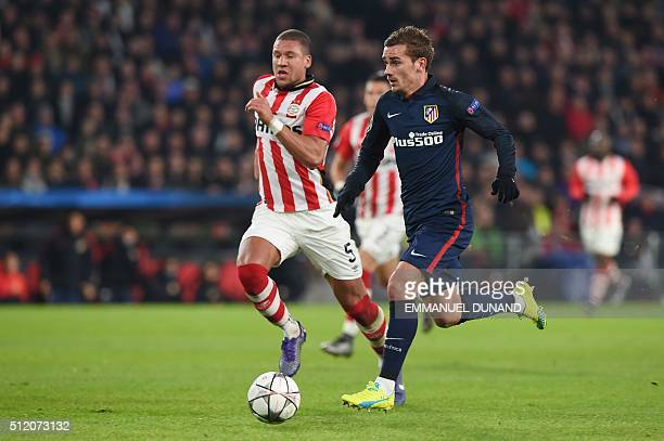 Atletico Madrid's French forward Antoine Griezmann challenges PSV Eindhoven's defender Jeffrey Bruma during the UEFA Champions League round of 16...