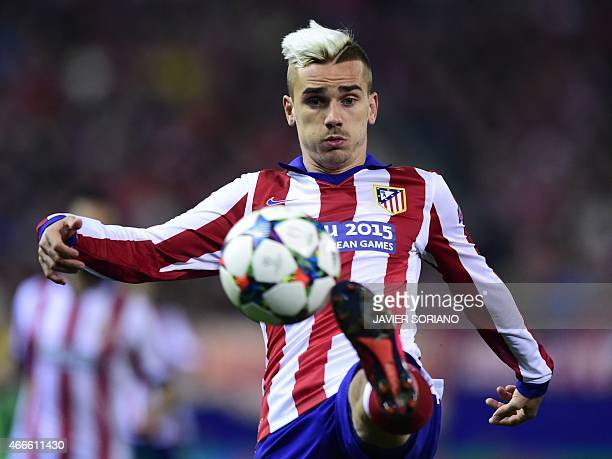 Atletico Madrid's French forward Antoine Griezmann controls the ball during the UEFA Champions League football match Club Atletico de Madrid vs Bayer...