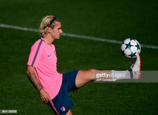 Atletico Madrid's French forward Antoine Griezmann controls the ball during a training session at the Wanda Metropolitano stadium in Madrid on...