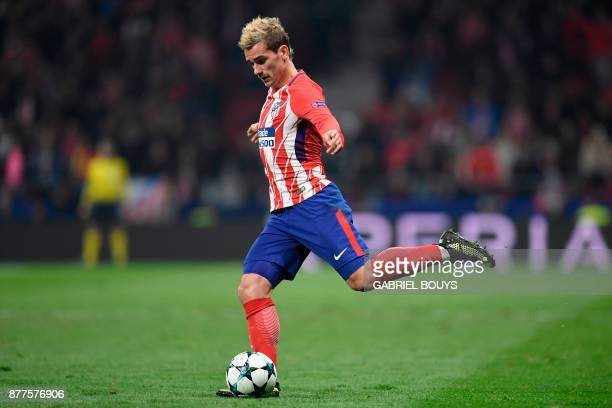 Atletico Madrid's French forward Antoine Griezmann controls the ball during the UEFA Champions League group C football match between Atletico Madrid...