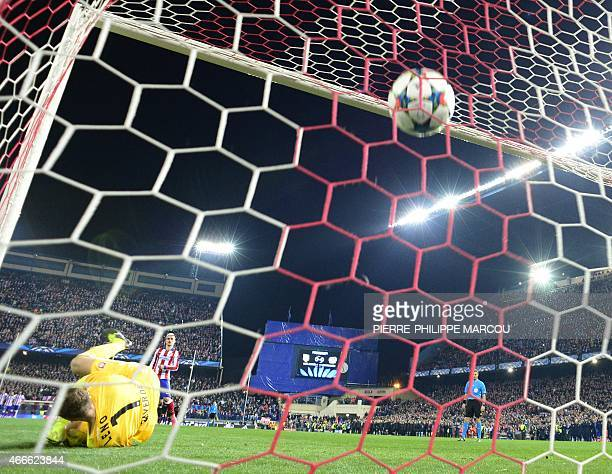 Atletico Madrid's French forward Antoine Griezmann kicks a penalty to score during the UEFA Champions League football match Club Atletico de Madrid...