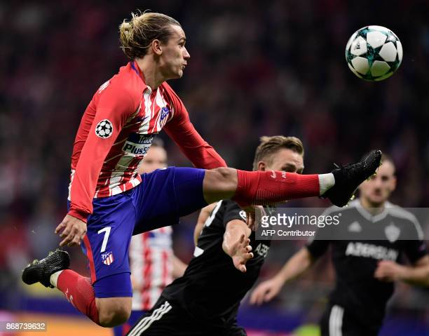 Atletico Madrid's French forward Antoine Griezmann kicks the ball during the UEFA Champions League football match Club Atletico de Madrid vs Qarabag...
