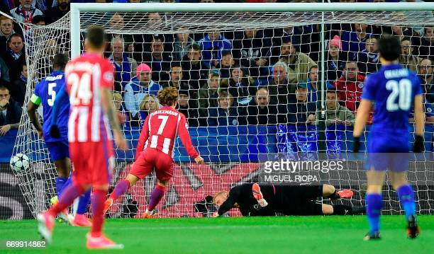 Atletico Madrid's French forward Antoine Griezmann reacts after Atletico Madrid's Spanish midfielder Saul Niguez scored his team's first goal during...
