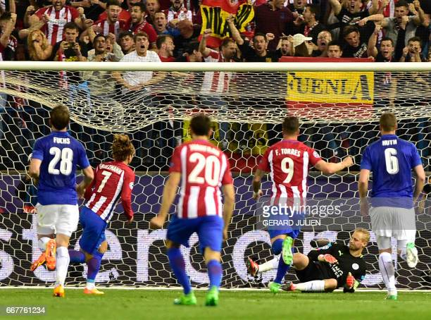 Atletico Madrid's French forward Antoine Griezmann scores a goal after shooting a penalty kick during the UEFA Champions League quarter final first...