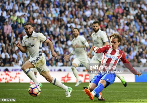 Atletico Madrid's French forward Antoine Griezmann scores a goal during the Spanish league football match Real Madrid CF vs Club Atletico de Madrid...