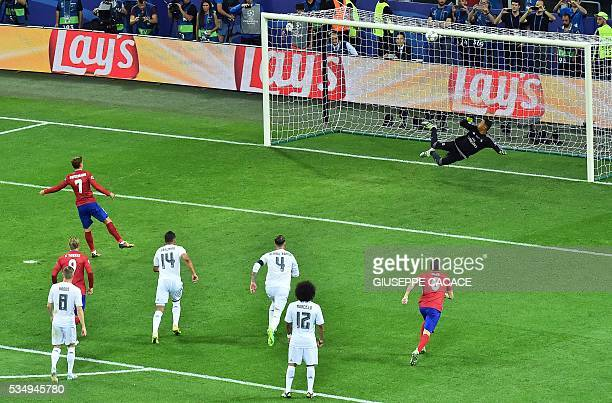 Atletico Madrid's French forward Antoine Griezmann shoots a penalty during the UEFA Champions League final football match between Real Madrid and...