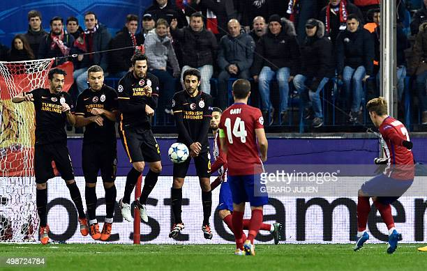 Atletico Madrid's French forward Antoine Griezmann shoots against Galatasaray's wall during the UEFA Champions League Group C football match Club...