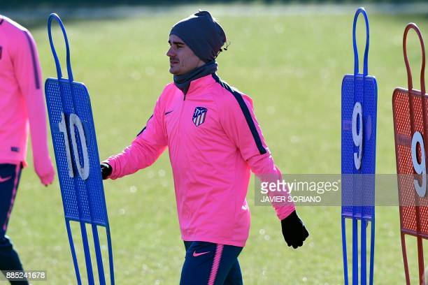 Atletico Madrid's French forward Antoine Griezmann takes part in a training session at Atletico de Madrid's sport city in Majadahonda near Madrid on...