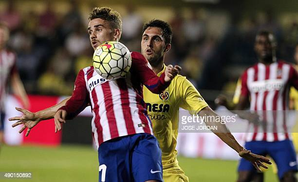 Atletico Madrid's French forward Antoine Griezmann vies with Villarreal's defender Victor Ruiz during the Spanish league football match Villarreal CF...