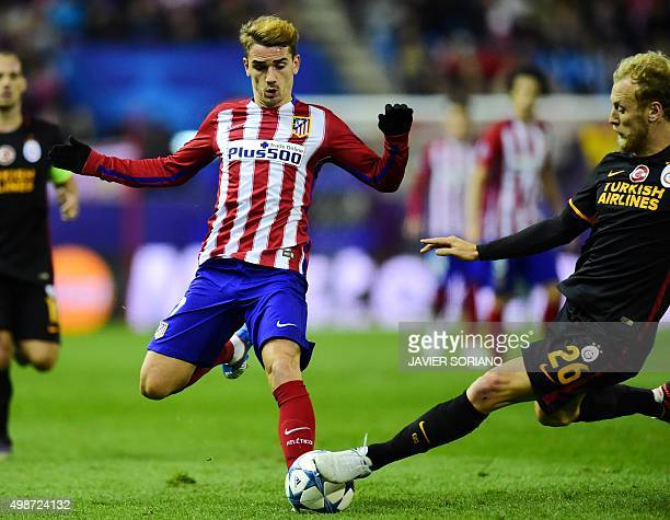 Atletico Madrid's French forward Antoine Griezmann vies with Galatasaray's defender Semih Kaya during the UEFA Champions League Group C football...