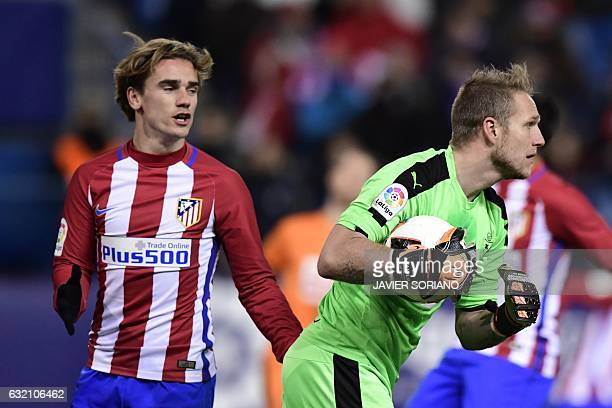 Atletico Madrid's French forward Antoine Griezmann vies with Eibar's goalkeeper Yoel Rodriguez during the Spanish Copa del Rey quarter final first...