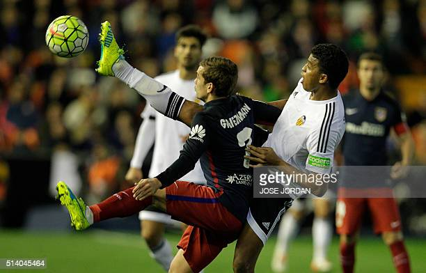 Atletico Madrid's French forward Antoine Griezmann vies with Valencia's Brazilian defender Aderlan Santos during the Spanish league football match...