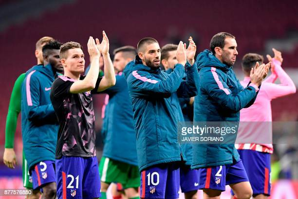 Atletico Madrid's French forward Kevin Gameiro Atletico Madrid's Belgian midfielder Yannick FerreiraCarrasco and Atletico Madrid's Uruguayan defender...