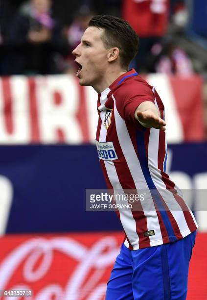 Atletico Madrid's French forward Kevin Gameiro celebrates a goal during the Spanish league football match Club Atletico de Madrid vs Valencia CF at...
