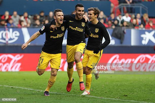 Atletico Madrid's French forward Kevin Gameiro celebrates with Atletico Madrid's Argentinian midfielder Angel Correa and Atletico Madrid's French...