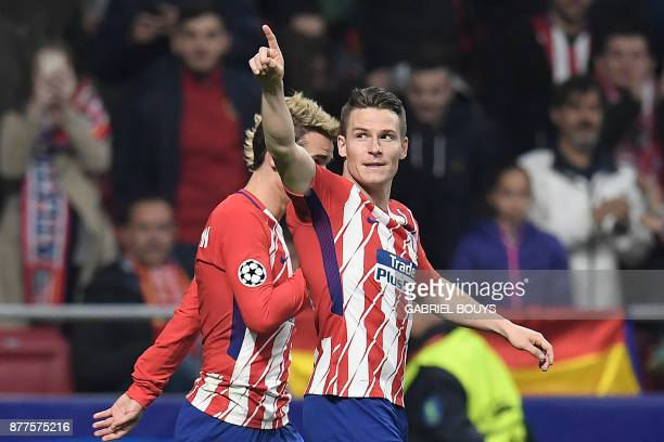 Atletico Madrid's French forward Kevin Gameiro celebrates with Atletico Madrid's French forward Antoine Griezmann after scoring his team's second...