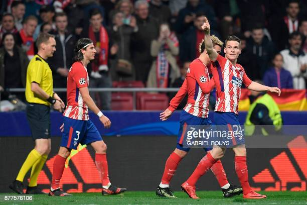 Atletico Madrid's French forward Kevin Gameiro celebrates with Atletico Madrid's French forward Antoine Griezmann and Atletico Madrid's Brazilian...