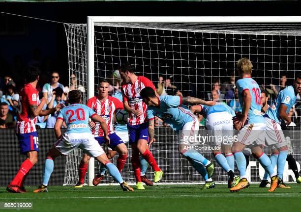 Atletico Madrid's French forward Kevin Gameiro scores a goal during the Spanish league football match RC Celta de Vigo vs Club Atletico de Madrid at...