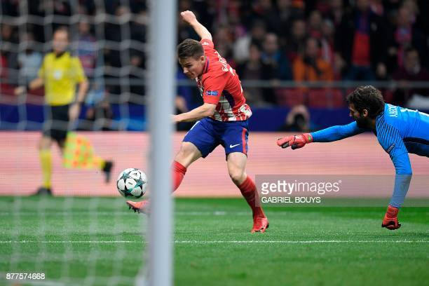 Atletico Madrid's French forward Kevin Gameiro scores past Roma's Brazilian goalkeeper Alisson during the UEFA Champions League group C football...