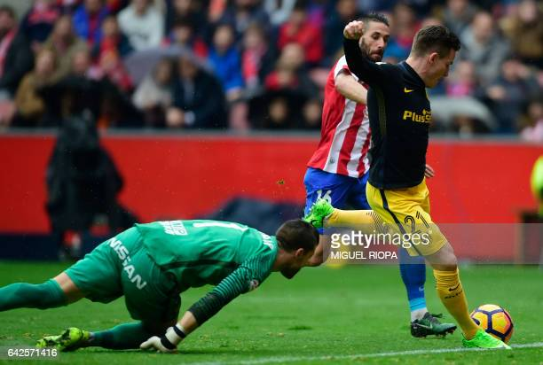 Atletico Madrid's French forward Kevin Gameiro shoots to score a goal during the Spanish league football match Real Sporting de Gijon vs Club...