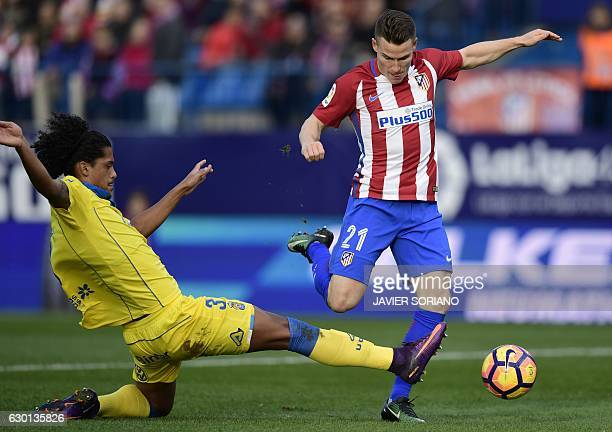 Atletico Madrid's French forward Kevin Gameiro vies with Las Palmas' Uruguayan defender Mauricio Lemos during the Spanish league football match Club...