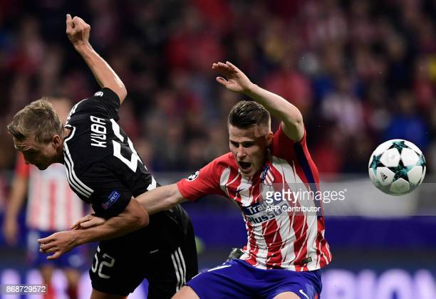 Atletico Madrid's French forward Kevin Gameiro vies with Qarabag's Polish defender Jakub Rzezniczak during the UEFA Champions League football match...