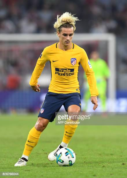 Atletico Madrid's French striker Antoine Griezmann plays the ball the final Audi Cup football match between Atletico Madrid and FC Liverpool in the...