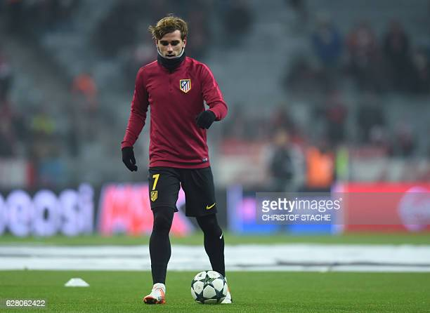 Atletico Madrid's French striker Antoine Griezmann warms up prior to the UEFA Champions League group D football match between FC Bayern Munich and...