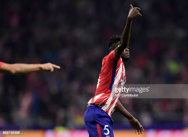 Atletico Madrid's Ghanaian midfielder Thomas celebrates a goal during the UEFA Champions League football match Club Atletico de Madrid vs Qarabag FK...