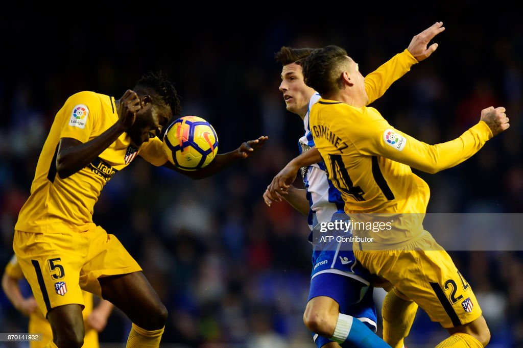 Atletico Madrid's Ghanaian midfielder Thomas Partey (L) and Atletico Madrid's Uruguayan defender Jose Maria Gimenez challenge Deportivo La Coruna's Swiss defender Fabian Schar (C) during the Spanish league football match Deportivo Coruna vs Atletico Madrid at the Riazor stadium in La Coruna on November 4, 2017. /