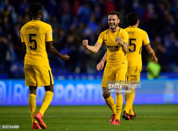 Atletico Madrid's Ghanaian midfielder Thomas Partey and midfielder Saul Niguez celebrate at the end of the Spanish league football match Deportivo...