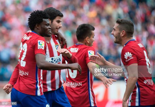 Atletico Madrid's Ghanaian midfielder Thomas Partey celebrates with teammates after scoring during the Spanish league football match Club Atletico de...