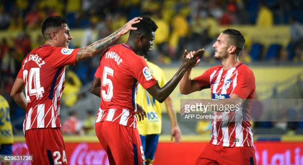 Atletico Madrid's Ghanaian midfielder Thomas Partey celebrates with teammates after scoring during the Spanish league football match UD Las Palmas vs...