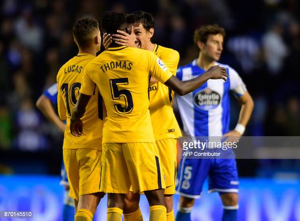 Atletico Madrid's Ghanaian midfielder Thomas Partey French defender Lucas Hernandez and Montenegrin defender Stefan Savic celebrate at the end of the...