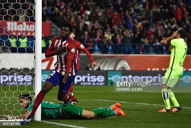 Atletico Madrid's Ghanaian midfielder Thomas Partey scores a goal past Levante's goalkeeper Diego Marino during the Spanish league football match...