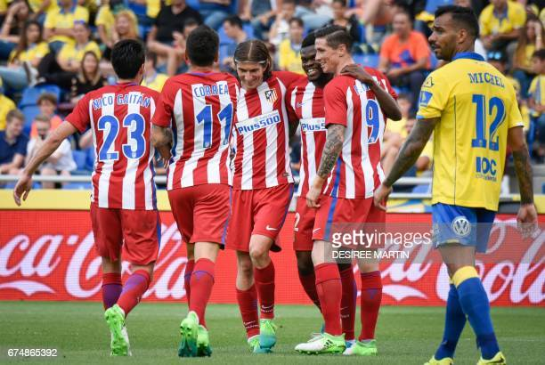Atletico Madrid's Ghanaian midfielder Thomas Partney celebrates with teammates after scoring during the Spanish league football match UD Las Palmas...