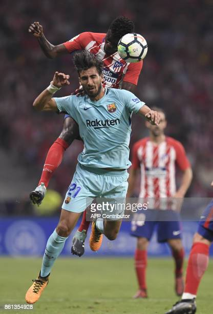 Atletico Madrid's Ghanaian midfielder Thomas vies with Barcelona's Portuguese midfielder Andre Gomes during the Spanish league football match Club...