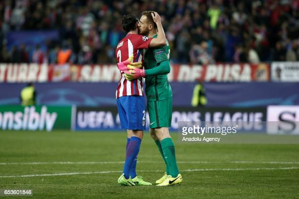 Atletico Madrid's goalkeeper Jan Oblak and his teammate Diego Godin congratulate each other during the UEFA Champions League Round of 16 football...