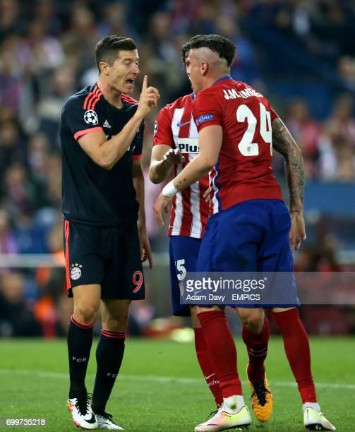 Atletico Madrid's Jose Gimenez argues with Bayern Munich's Robert Lewandowski