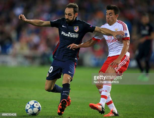Atletico Madrid's Juanfran battles to hold off challenge from Benfica's Nico Gaitan