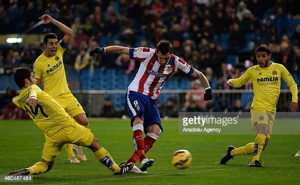 Atletico Madrid's Mandzukic vies for the ball with Villarreal's Trigueros Bruno Soriano and Jonathan dos Santos Ramirez during Spanish league La Liga...