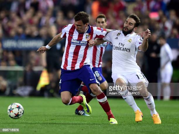 Atletico Madrid's Mario Mandzukic and Real Madrid's Dani Carvajal in action