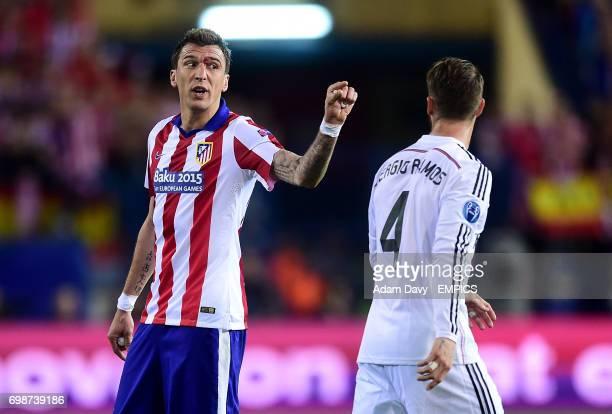 Atletico Madrid's Mario Mandzukic argues with Real Madrid's Sergio Ramos