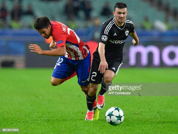Atletico Madrid's midfielder from Argentina Nico Gaitan and Qarabag's defender from Azerbaijan Gara Garayev vie for the ball during the UEFA...