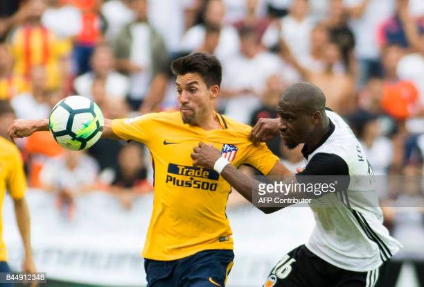 Atletico Madrid's midfielder from Argentina Nico Gaitan vies with Valencia's midfielder from France Geoffrey Kondogbia during the Spanish Liga...