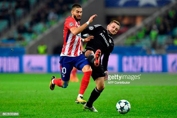 Atletico Madrid's midfielder from Belgium Yannick FerreiraCarrasco and Qarabag's defender from Azerbaijan Maksim Medvedev vie for the ball during the...