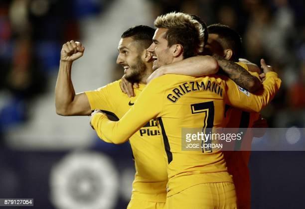 Atletico Madrid's midfielder from Spain Koke and Atletico Madrid's forward from France Antoine Griezmann celebrate after Levante's Spanish defender...
